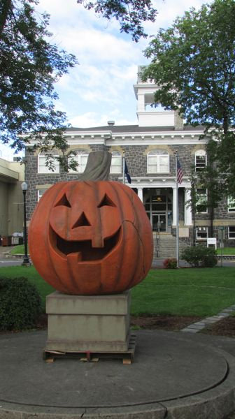 by: MARK MILLER - The Great Pumpkin of Old Town stands watch over Courthouse Plaza in St. Helens on Wednesday, Sept. 25.