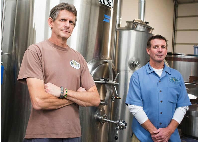by: HILLSBORO TRIBUNE PHOTO: CHASE ALLGOOD - Vertigo Brewing co-owners Mike Haines (left) and Michael Kinion are ready to celebrate five years in the brewery business.