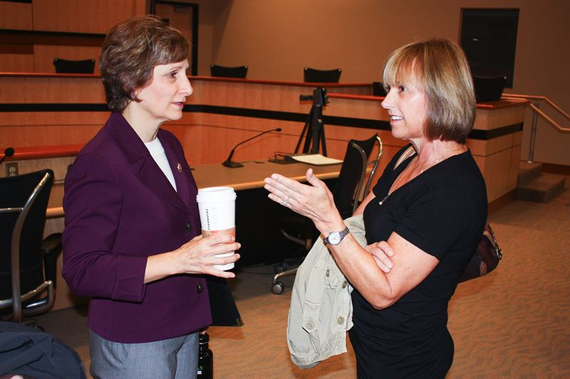 by: HILLSBORO TRIBUNE PHOTO: DOUG BURKHARDT - U.S. Rep. Suzanne Bonamici chats with a constituent after Sundays town hall event at the Hillsboro Civic Center.