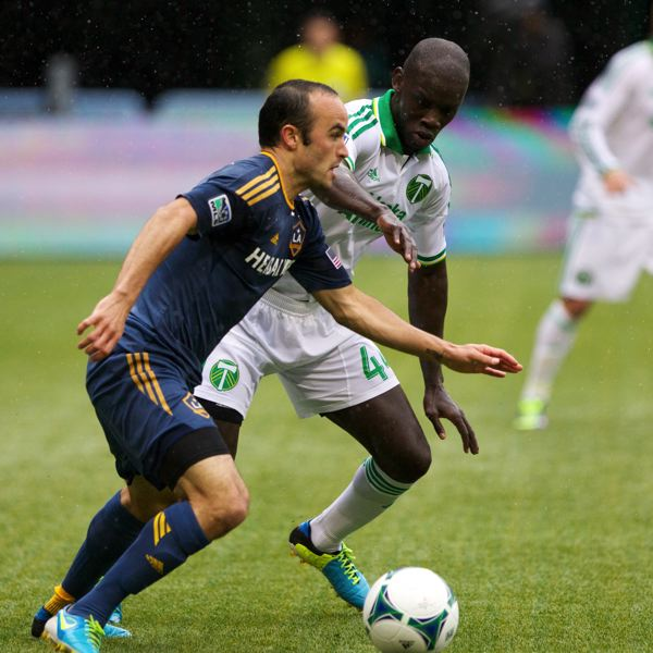 by: TRIBUNE PHOTO: JAIME VALDEZ - Portland Timbers defender Pa Modou Kah (right) defends Los Angeles Galaxy midfielder Landon Donovan at Jeld-Wen Field.
