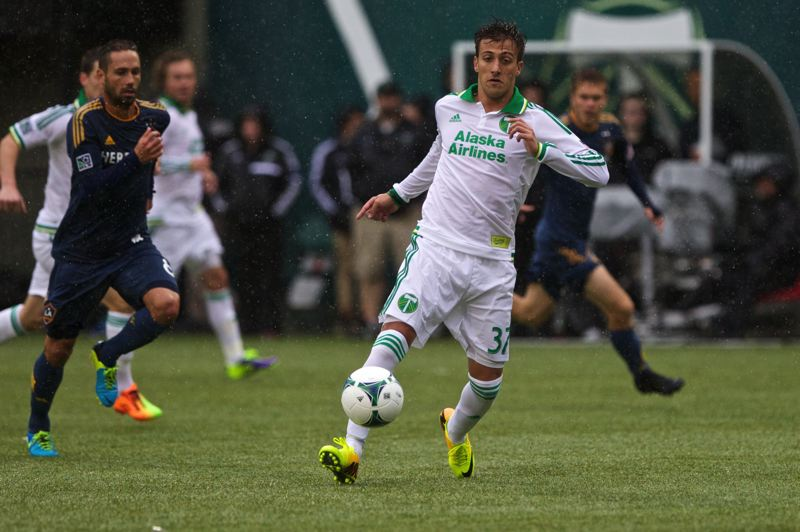 by: TRIBUNE PHOTO: JAIME VALDEZ - Portland Timbers forward Maximiliano Urruti heads upfield during Sunday's home match against the Los Angeles Galaxy.
