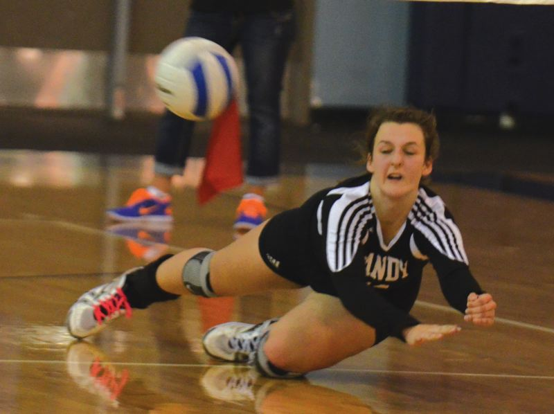 by: PAMPLIN MEDIA GROUP: JEFF GOODMAN - Sandys Alex Ford goes to the floor for a dig during Thursday nights four-set loss at Wilsonville. The team split their matches this week, sweeping Milwaukie earlier in the week.