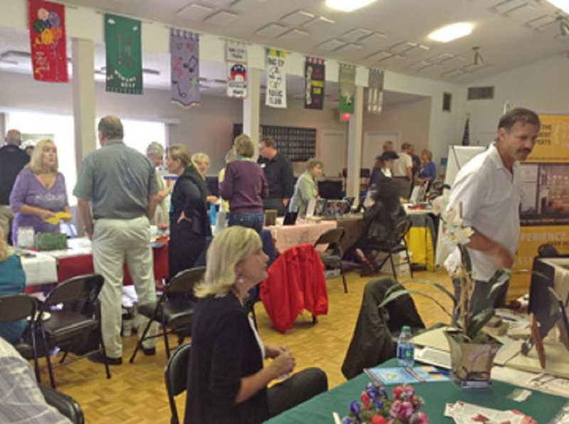 by: COURTESY OF KATHY PEPER - WHERE THE ACTION IS - At the Sept. 6 King City Expo, people could meander through all the rooms in the King City Clubhouse, including the banquet room, talking to vendors and picking up information.