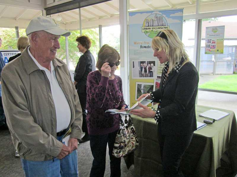 by: BARBARA SHERMAN - EXCURSIONS JUST FOR SENIORS -- At the  King City Expo, Polly Bangs (right) of Urban Excursions chats with King City residents Frank Passmore and Lorna Irving about her business that offers weekly adventures for seniors who are homebound. For more information, visit www.urbanexcursionspdx.com, email <span id=