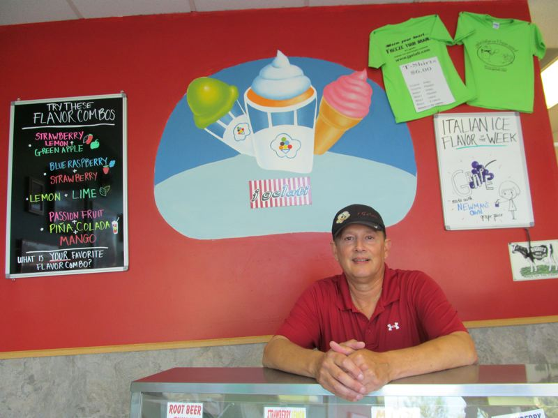 by: PHOTO BY: ELLEN SPITALERI - John Greer, owner of J Gelati in Holly Farms Plaza, is preparing more than just cupcakes and cookies for Northwest Housing Alternatives' annual chocolate-tasting fundraiser.