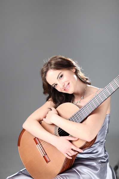 by: SUBMITTED PHOTO - Croatian guitar virtuoso Ana Vidovic will open Portland Classic Guitars concert series Oct. 11 in St. Annes Chapel on the Marylhurst University campus. Tickets are available online.