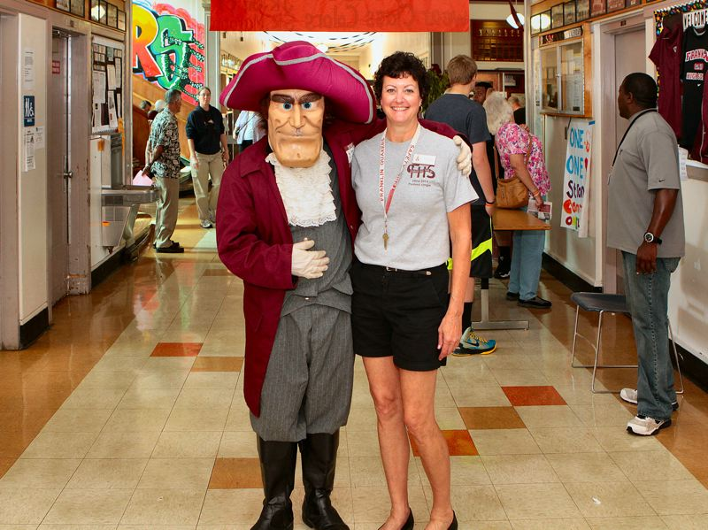by: DAVID F. ASHTON - The schools Benj. Franklin mascot gives a big welcoming hug to Franklin Alumni Association President Pam Knuth.