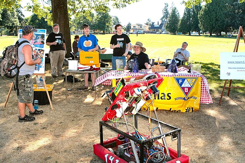 by: DAVID F. ASHTON - During the August Lents Founders Day celebration, FIRST Robotics Competition Team 1432 was on hand to demonstrate how their robot, used in this springs regional competition, launches flying disks. They were also presenting at the Multnomah County Fair at Oaks Park on Memorial Day weekend.