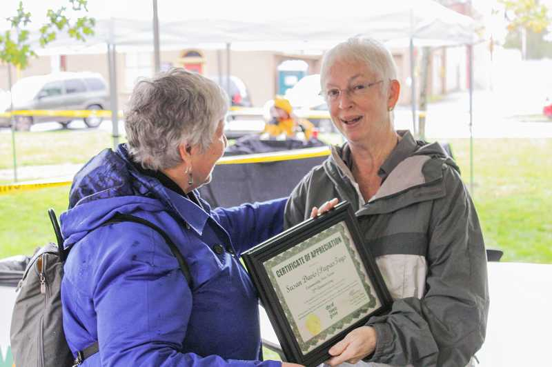 by: NEWS-TIMES PHOTO: JOHN SCHRAG - Susan Davis (right) receives a certificate of appreciation from Forest Grove parks commission chair Susan Taylor during last weeks Corn Roast. For the past 20 years, the Davis family has sponsored free Saturday evening swim nights at the citys aquatic center so that low-income residents can enjoy the facility. Parks director Tom Gamble said that translates into 40,000 free pool admissions. The family also supports Doernbecher Childrens Hospital by hosting an annual open house to show off its Papas Toys classic car collection in Cornelius.