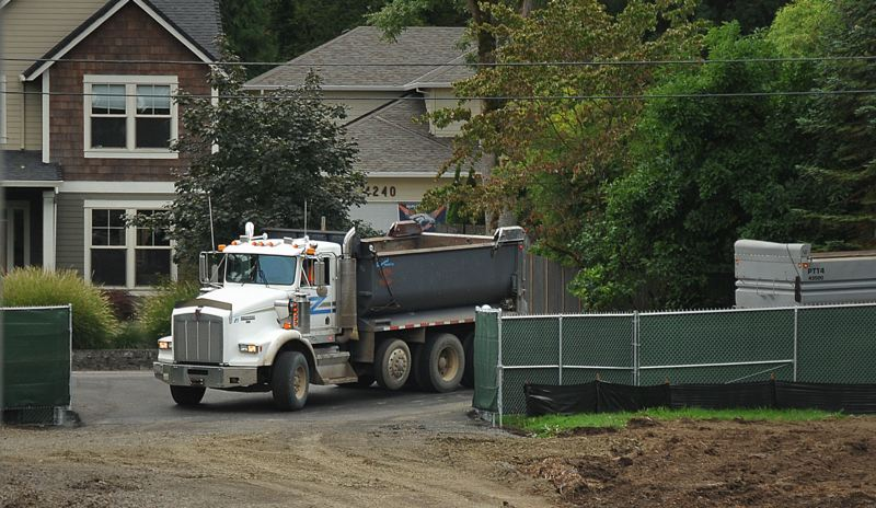 by: VERN UYETAKE - Dump trucks enter the water treatment plant on Mapleton Drive in West Linn and exit on Kenthorpe Way.