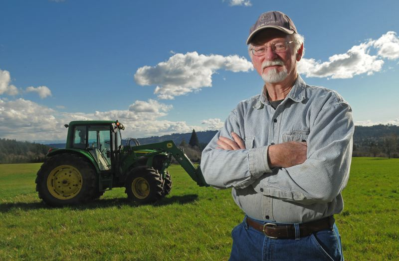 by: VERN UYETAKE - In this file photo, Stafford Hamlet Chairman Mike Miller stands in Stafford, an unincorporated area in Clackamas County between Lake Oswego, Tualatin and West Linn. Miller is considered a small-property owner in the area but helps manage much larger properties and offers tractor work in the area, long looked at for urban development to handle regional growth.
