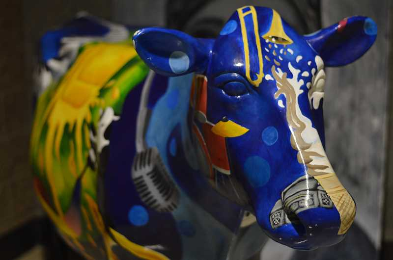 by: ROLLIN DICKINSON - A painted cow stands as a reminder of a Lakeridge student's artistic skills.
