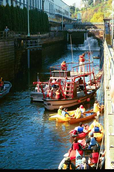 by: FILE PHOTO: WILLAMETTE FALLS HERITAGE FOUNDATION  - A boat carries U.S. Rep. Darlene Hooley through the locks in 2002, in the first flotilla for the locks.