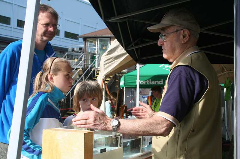 by: FILE PHOTO: WILLAMETTE FALLS HERITAGE FOUNDATION  - Al Lewis demonstrates his working model of the locks for visitors to Lock Fest last year. He will be there again this year.
