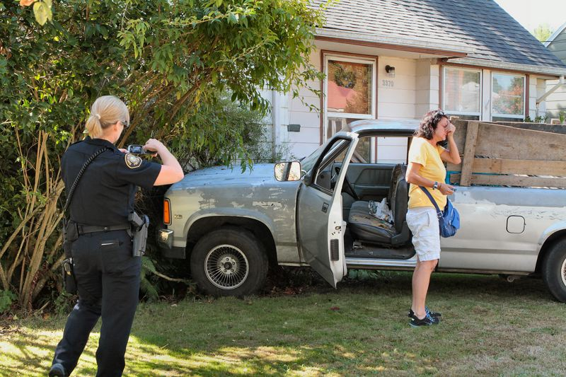 by: DAVID F. ASHTON - After crashing into this house, police say, the driver took off - leaving his flustered passenger behind.