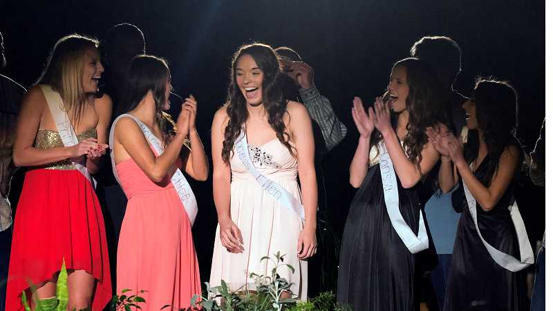 by: RAY HUGHEY - Ellen Dula reacts as her name is announced as the 2013 Canby High School homecoming queen at a Sept. 23 school assembly