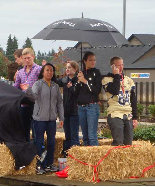 by: JOHN BAKER - The homecoming parade was something to cheer about, but the weather wasn't.