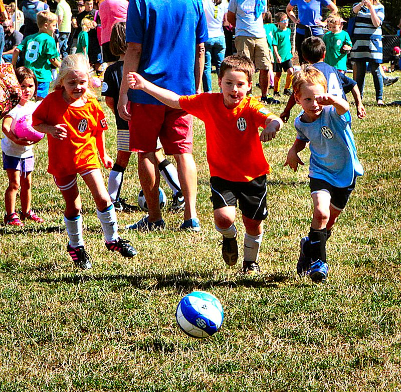 by: DAVID F. ASHTON - Here come Crush teammates Molly Mitchoff and Brady Ryan, running the ball during the Southeast Soccer Club Mighty Mites Jamboree in Eastmoreland.