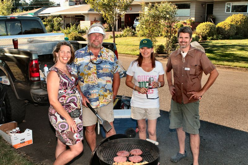 by: DAVID F. ASHTON - Helping everyone to have a good time is the BBQs organizer, Kessa Shipley, along with Reed Neighborhood Association President Mark Gossage and the associations Treasurer Michelle Maida, and Past President and Board member Gabe Headrick.