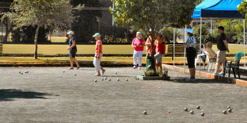 by: DAVID F. ASHTON - Looking at the playing area from the side, these boules show several games in play at the same time.