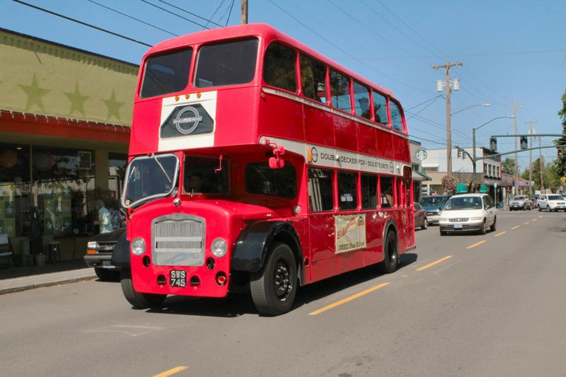 by: DAVID F. ASHTON - The SWBA Passport Day double-decker bus rolls through Westmoreland, on S.E. Milwaukie Avenue.