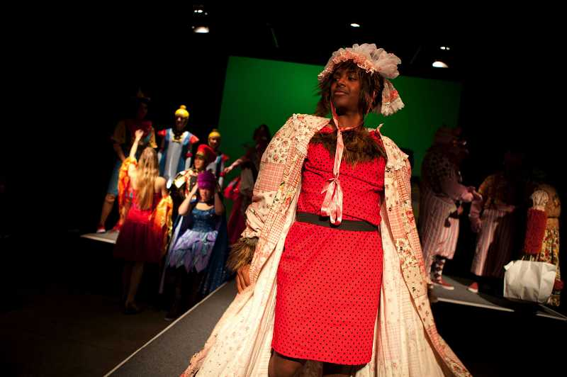 by: TIMES PHOTO: ADAM WICKHAM - Jesuit High School's Noah Kulala portrays The Wolf in Granny's wardrobe during Tuesday night's fashion show.