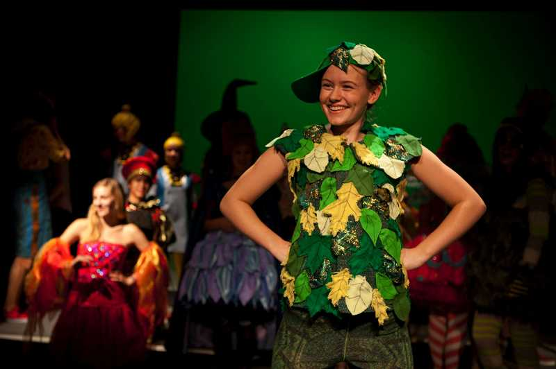 by: TIMES PHOTO: ADAM WICKHAM - Jesuit High School's Emily Strand steps out as Peter Pan during a fashion show designed to show off costumes of beloved characters from the drama program's past and future productions.