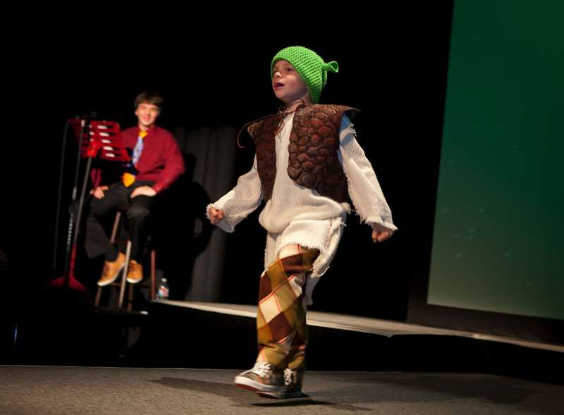 by: TIMES PHOTO: ADAM WICKHAM - Tuesday's fashion show featured 8-year-old Trevor Beale strutting down the runway as Young Shrek.