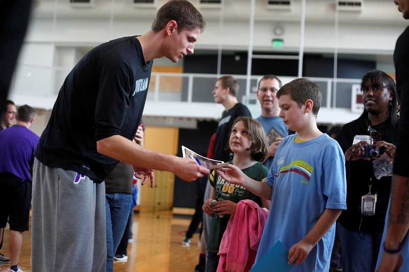 by: TIMES PHOTO: JONATHAN HOUSE - Netherlands native and University of Portland center Thomas van der Mars was on hand with his teammates for a basketball clinic and autograph-signing session on the Nike campus for the kids of Special Olympics Oregon.