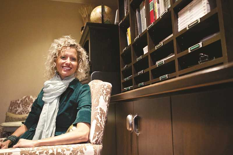 by: TIMES PHOTO: JAIME VALDEZ - Restoring Order owner Vicki Norris sits in her office at her home in Sherwood, where she meets with clients and helps them get organized.