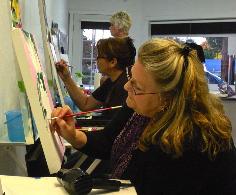 by: POST PHOTO: JIM HART - Diane Reed, foreground, Kim Yamashita, middle, and Sandy Jordan, background, quietly work on their individual art pieces during a class led by Sandy artist Lori Ryland, not pictured.