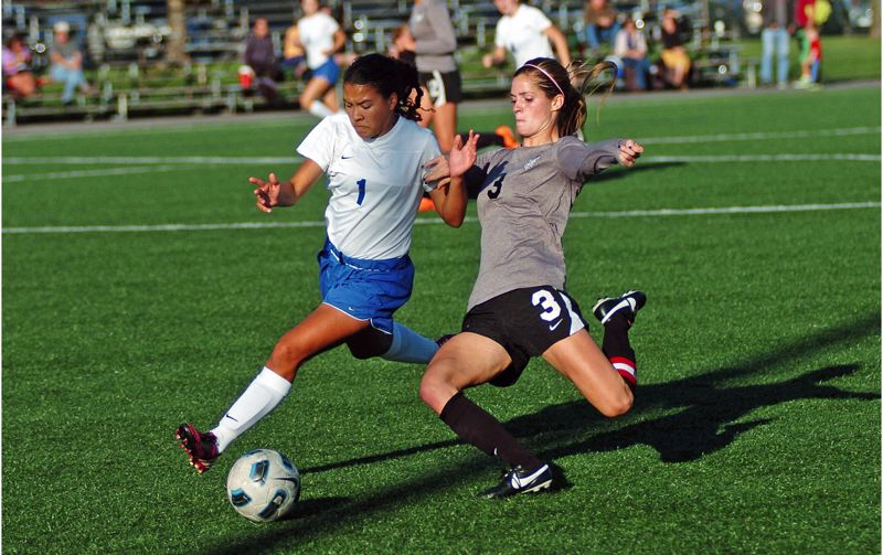 by: DAN BROOD - GO GET IT -- Tualatin High School senior Jill Farley (right) battles Grant sophomore Janelle Arnold for the ball during last Thursday's non-league match held at Strasser Field. Farley scored a goal for the Timberwolves in their 4-0 victory.