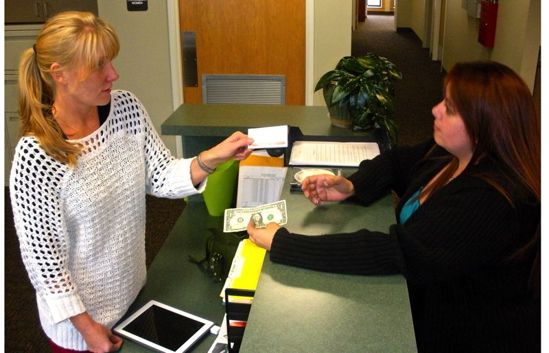 by: POST PHOTO: JIM HART - At the Sandy Transit Operations Center, Janice Johnson of Sandy, right, purchases a transit ticket from Transit Assistant Andi Howell. Tickets also are available at Sandy City Hall and the Sandy Community Center. Fares for all buses went into effect Tuesday, Oct. 1.