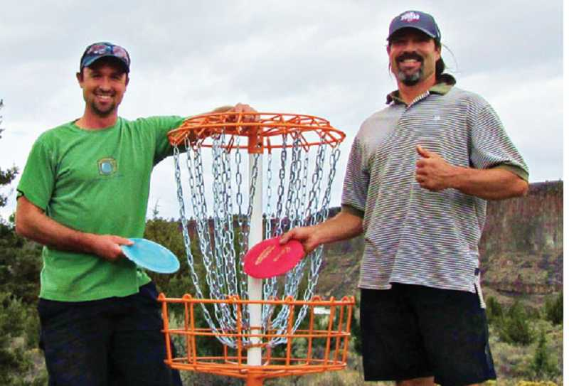 by: SUBMITTED PHOTO - Rancher Sean Remer, left, designed the disc golf course with the help of Jim Tobish, also of CRR.