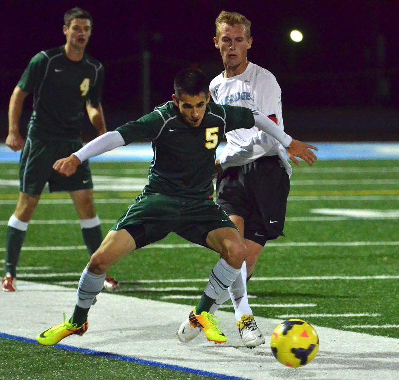 by: VERN UYETAKE - West Linn's Ryan Barber shields the ball during the Lions' 1-0 win over Lakeridge last week.