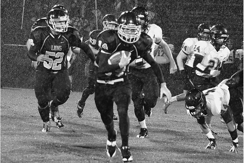 by: FILE PHOTO - Gage Bumgardner runs the ball during last year's match up with Sandy. Bumgardner will likely shoulder more of the rushing attempts with Brennan Norton out for the season.
