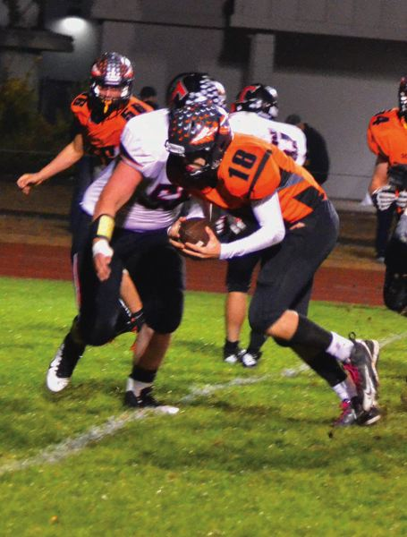 by: FILE PHOTO - Taylor Loss runs in a touchdown against Yamhill-Carlton during last years' road victory.