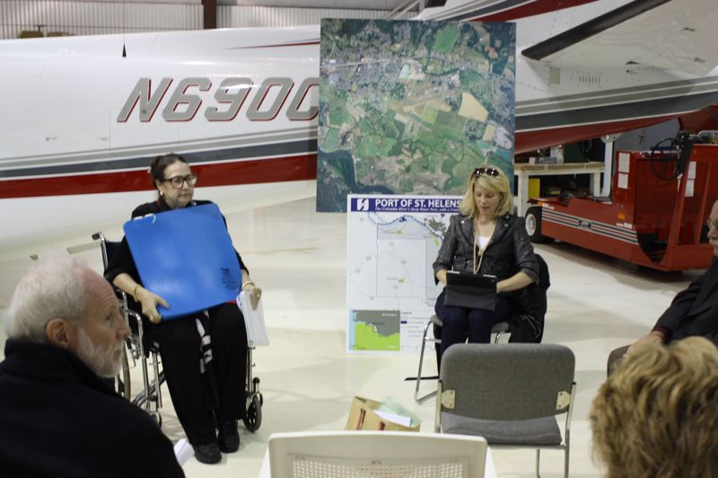 by: SPOTLIGHT PHOTO: ROBIN JOHNSON - State Sen. Betsy Johnson, D- Scappoose, displays a mat developed by Oregon Aero Thursday, Oct. 3. that relieves moisture, heat and pressure from underneath the user. Johnson has been using the mat with her wheelchair since her car accident in April which fractured her pelvis. Karmen Fore (right), sustainable communities and transportation policy advisor to Governor John Kitzhaber takes notes at a meting with Scappoose Industrial Airpark businesses and port representatives.
