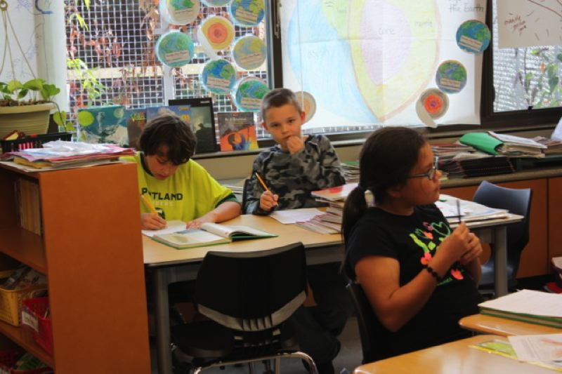 by: SPOTLIGHT PHOTO: ROBIN JOHNSON - Fourth-grade students in Kristy Larsons class at Otto Peterson Elementary worked on geology classwork on the day they were supposed to visit Mount St. Helens.