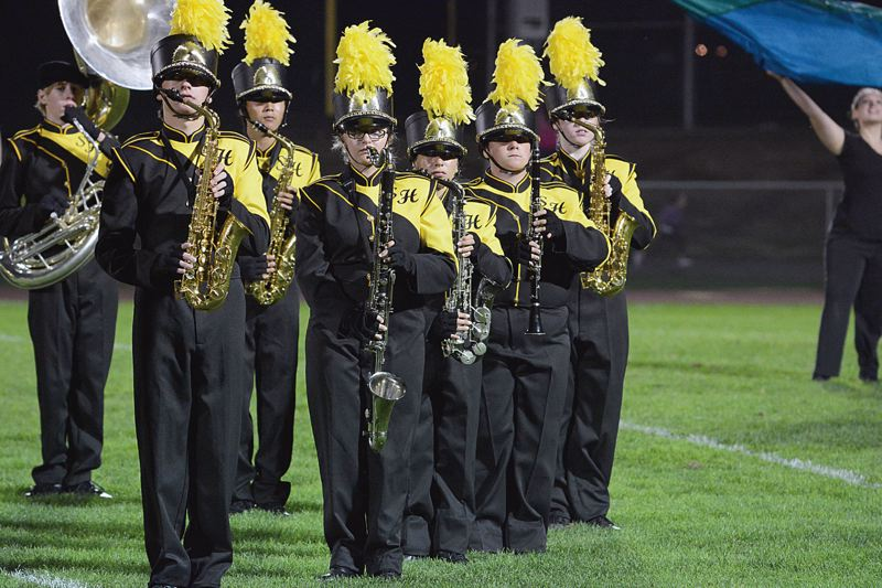 by: SPOTLIGHT PHOTO: MARK MILLER - The St. Helens High School marching band performs at halftime during a home football game against Liberty High School on Sept. 13.