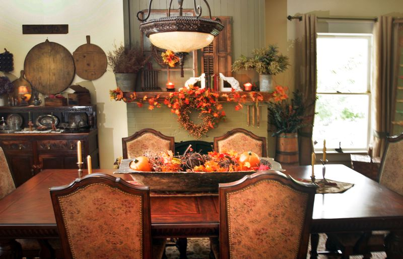 by: OUTLOOK PHOTO: JIM CLARK - The Walstons have decorated their dining room in a century-old fashion.