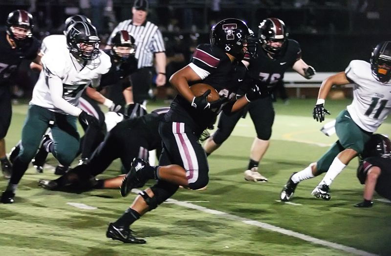 by: DAN BROOD - RUNNING STRONG -- Tualatin junior Eli Robinson looks to head up field during Friday's game.