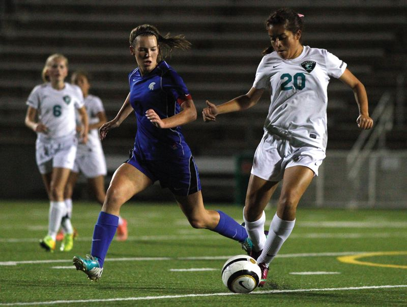 by: HILLSBORO TRIBUNE PHOTO: AMANDA MILES - Century midfielder Vicky Monterroso dribbles away from Hillsboro's Kylee Taube during Tuesday's Pacific Conference soccer match. Hilhi won 4-2 to remain undefeated in league play.