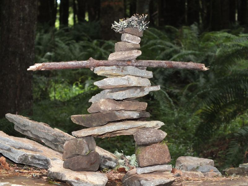 by: PHOTO COURTESY: MONICA KOMPERDA - Stoneman art created by Tim Delano, community forestry educator at Hopkins Demonstration Forest, is made of rocks, a stick and lichen found beside the road. Other people are stacking and organizing rocks here in various ways in preparation for the Oregon City event, and beyond, as 'guerrilla art.'