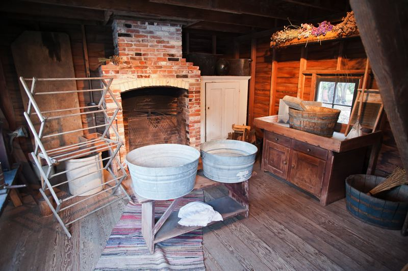 by: SPOKESMAN PHOTO: JOSH KULLA - Some Aurora colonists lived relatively rudimentary lives by todays standards. Shown is the washroom of an early house that remains part of the museum.