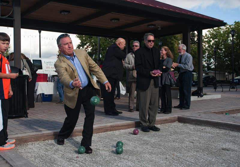 by: SPOKESMAN PHOTO: JOSH KULLA - Bocce courts, shown being used by Costa Pacific CEO Rudy Kadlub, are a part of the European-flavored Piazza Park at Villebois, which was dedicated last week with a ceremony honoring the former Dammasch State Hospital.