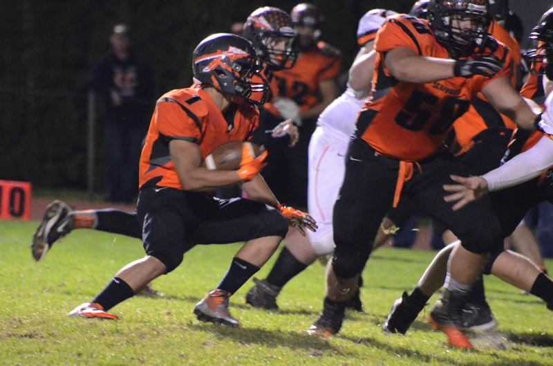 by: JOHN BREWINGTON - Carson Davison (1) looks for an open gap in the defense. Davison rushed for 86 yards against Yamhill-Carlton on Oct. 4, the second-highest total for his senior season.
