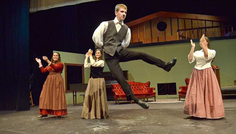 by: PAMPLIN MEDIA GROUP: VERN UYETAKE - Playing the March sisters neighbor, Laurie, Aaron Gilbert rises in the air during a dance number.