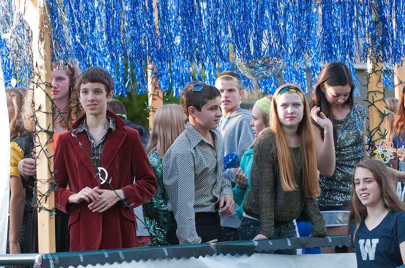 by: SPOKESMAN PHOTO: JOSH KULLA - Freshmen participate in their first homecoming parade.
