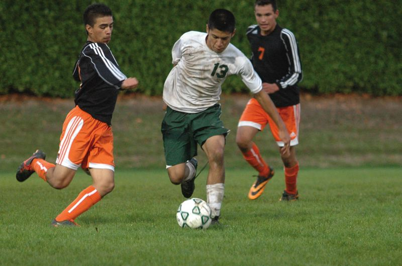 by: ESTACADA NEWS: PARKER LEE - Estacadas Alredo Belman dribbles down the center of the field during last weeks 2-0 loss to Gladstone.
